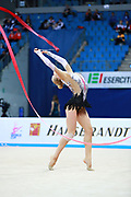 Moustafaeva Kseniya of France competes during the Rhythmic Gymnastics Individual ribbon qulification of the World Cup at Adriatic Arena on April 2, 2016 in Pesaro, Italy. She  is a French individual rhythmic gymnast of Belarusian origin born in Minsk in 1994.