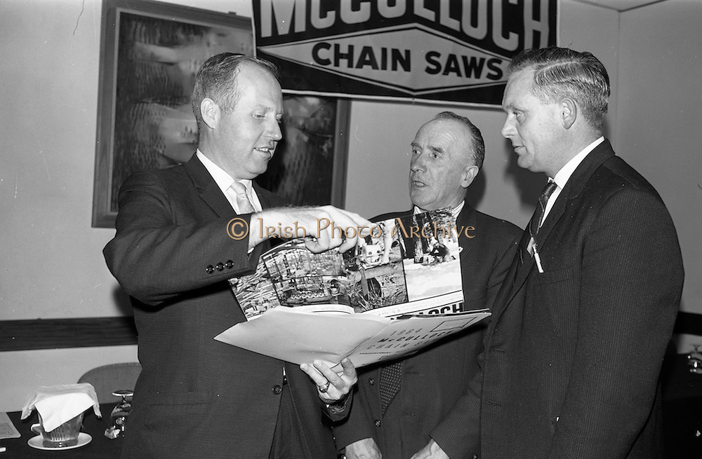 19/09/1963<br /> 09/19/1963<br /> 19 September 1963<br /> McCulloch's Chainsaws dealers meeting at the Intercontinental Hotel, Dublin. Picture shows Mr. Gene Koll, McCullochs International, Los Angeles chatting with Mr. M. O'Shea, M.D. O'Shea and Sons Ltd., Killarney and Mr. J. Lucey, Lucey and O'Connell Ltd., Cork.