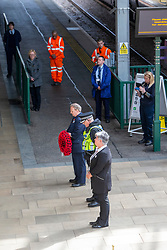 Staff take part in the two minute silence for VE day at the War Memorial at Waverley Station.<br /> Station Manager Juliet Donnachie, S/Inspector Chris Jamieson and Shift Station Manager Bruce Blackie.