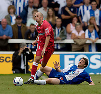 Photo: Jed Wee.<br />Hartlepool United v Swindon Town. Coca Cola League 2.<br />05/08/2006.<br /><br />Swindon's Jack Smith (L) feels the force of a challenge from Hartlepool's Joel Porter.