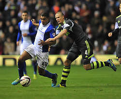 Birmingham City's Tom Adeyemi battles for the ball with Stoke City's Robert Huth -  - Photo mandatory by-line: Alex James/JMP - Tel: Mobile: 07966 386802 29/10/2013 - SPORT - FOOTBALL - ST Andrew's - Birmingham - Birmingham City v Stoke City - Capital One Cup - Forth Round