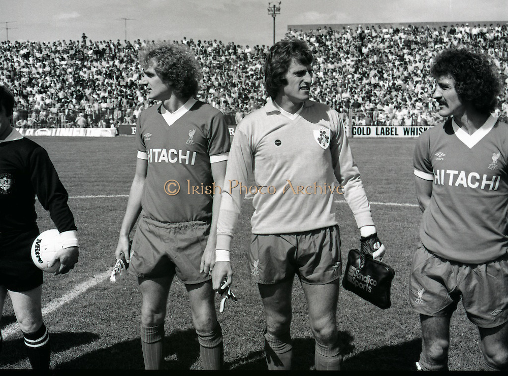 League of Ireland vs Liverpool FC.    (M87)..1979..18.08.1979..08.18.1979..18th August !979..In a pre season friendly the League of Ireland took on Liverpool FC at Dalymount Park Phibsborough,Dublin. The league team was made up of a selection of players from several League of Ireland clubs and was captained by the legendary John Giles. Liverpool won the game by 2 goals to nil..The scorers were Hansen and McDermott..Image shows Liverpool players Phil Thompson, Ray Clemence and Terry McDermott lining up before kick off.