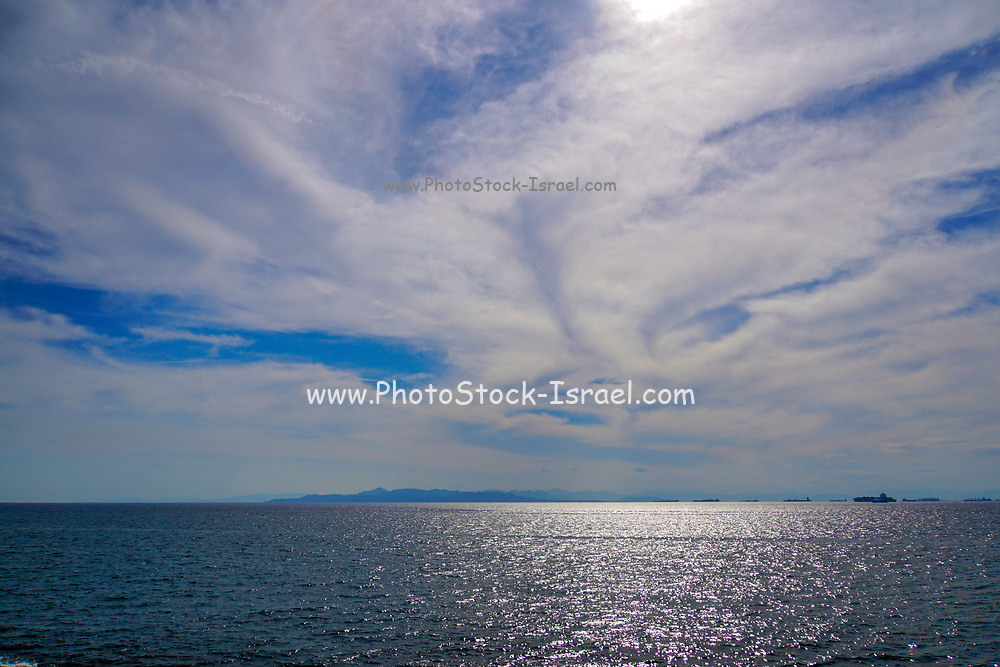 Seascape and cloudscape. Looking out over the Mediterranean Sea from Athens Greece