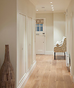 Hallway in house with armchair and pot