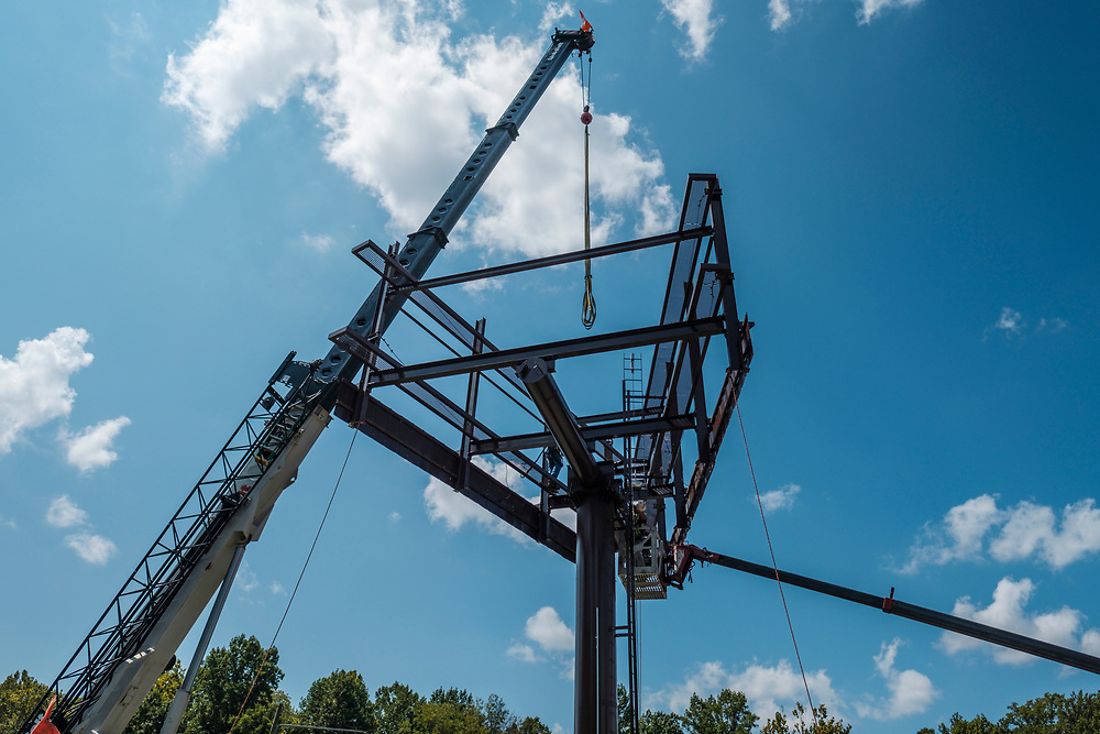 Technicians from Lamar Advertising install a digital billboard structure along Wards Road in Lynchburg, VA Wednesday, August 29, 2018. U.S. companies are investing in re-training efforts to fill a slew of open positions as a tight labor market and changing job requirements makes it hard to find qualified staffers.<br /> CREDIT: Justin Ide for The Wall Street Journal<br /> RETRAIN