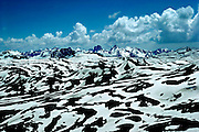 """Mountain peaks of the """"The Serious Wild"""" rise  more than 14,000 feet above sea level and loom over the melting snowfields of the Continental Divide between Silverton and Durango, Colorado."""