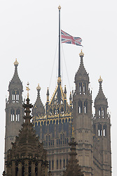 © Licensed to London News Pictures. 09/04/2013. London, UK. The Union Jack flag on the roof of the Houses of Parliament in London is seen flying at half mast as a sign of respect for former British Prime Minister Baroness Thatcher who died yesterday (08/04/2013) after a stroke. Photo credit: Matt Cetti-Roberts/LNP