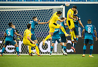 SAINT PETERSBURG, RUSSIA - DECEMBER 08: Artem Dzyuba of Zenit St. Petersburg beats Emre Can [left] and Jude Bellingham [right] of Borussia Dortmund to the header during the UEFA Champions League Group F stage match between Zenit St. Petersburg and Borussia Dortmund at Gazprom Arena on December 8, 2020 in Saint Petersburg, Russia. (Photo by MB Media)