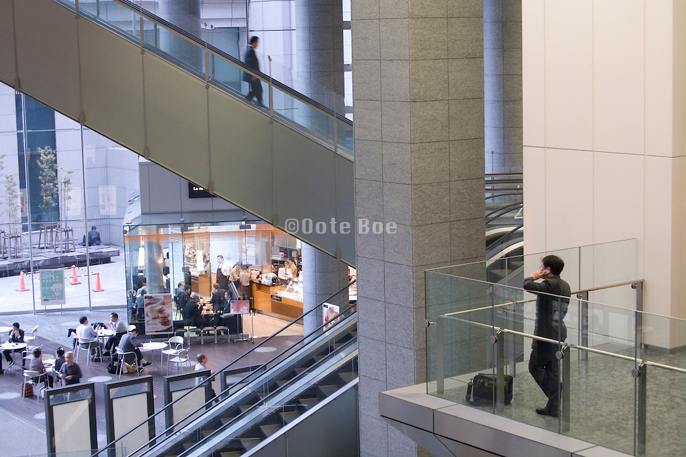 businessman talking on his cellphone in the lobby of a large office building