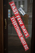 Diagonal stickers display the words 'Last Few Days, Everything Must Go', attached to the glass door of a closed business on Fleet Street, in the City of London, the capital's financial district aka the Square Mile, on 10th Match 2020, in London, England.