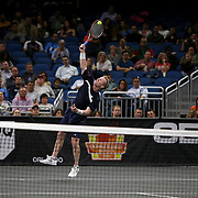 Tennis pro Jim Courier serves the ball as he competes against John McEnroe during the PowerShares Tennis Series event at the Amway Center on January 5, 2017 in Orlando, Florida. (Alex Menendez via AP)