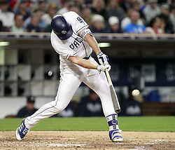 June 28, 2017 - San Diego, CA, USA - The San Diego Padres' Hunter Renfroe hits a two-run triple against the Atlanta Braves in the fourth inning at Petco Park in San Diego on Wednesday, June 28, 2017. (Credit Image: © Hayne Palmour Iv/TNS via ZUMA Wire)