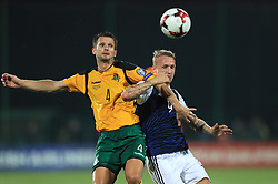 Lithuania's Tadas Kijanskas (left) and Scotland's Leigh Griffiths battle for the ball during the 2018 FIFA World Cup Qualifying, Group F match at the LFF Stadium, Vilnius.