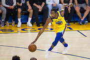 Golden State Warriors forward Kevin Durant (35) handles the ball against the Milwaukee Bucks at Oracle Arena in Oakland, Calif., on March 29, 2018. (Stan Olszewski/Special to S.F. Examiner)
