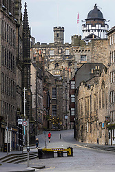 Empty Streets, Edinburgh, 05 April 2020 <br /> <br /> Pictured: On the day that Edinburgh would usually have a Streets Open day where cars are banned from the city streets, the public of Edinburgh heeds the Government calls to remain at home. Only a handful of joggers and dog walkers are seen on the streets are the usually bustling Royal Mile and Castle<br />  <br /> (c) Richard Dyson | EdinburghElitemedia.co.uk 2020