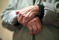 Embargoed to 0001 Saturday November 17 File photo dated 21/12/17 of the hands of an elderly woman. One in six over-65s have no-one to talk to about money issues, Age UK has found.