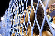Adoring young girl fan of Salgueiro Samba School shouts appreciation through a fence, before they practice their Carnival procession in the Sambadrome, Rio de Janeiro, Brazil