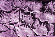 Lotus Flower stone sculpture textured and magenta pink color wall.