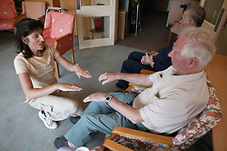 Teacher and elderly man taking part in a Music and Movement therapy class,