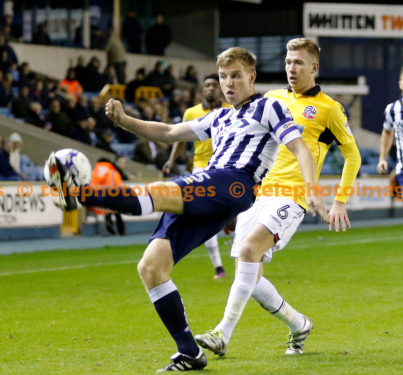 Millwall's Tony Craig hooks the ball clear during the Sky Bet League 1 match between Millwall and Bolton Wanderers at The Den in London. October 18, 2016.<br /> Carlton Myrie / Telephoto Images<br /> +44 7967 642437