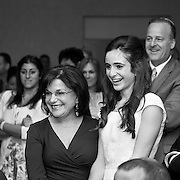 Bat Mitzvah girl and her grandmother laugh together, black & white