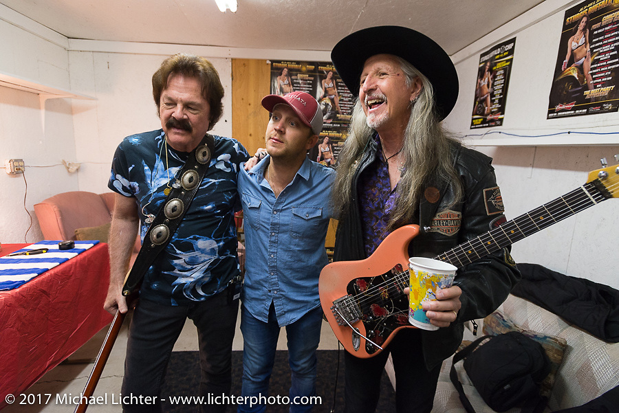 Country singer Justin Moore visits the Doobie Brothers' Tommy Johnston (L) and Pat Simmons (R) in their tuning room after opening for them and before the Doobies went on stage as the main act at the Buffalo Chip on Monday during the annual Sturgis Black Hills Motorcycle Rally. Sturgis, SD, USA. August 7, 2017. Photography ©2017 Michael Lichter.