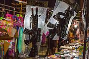 14 MARCH 2014 - NAKHON CHAI SI, NAKHON PATHOM, THAILAND: Toy guns for sale at the temple fair for the Wat Bang Phra tattoo festival.    PHOTO BY JACK KURTZ