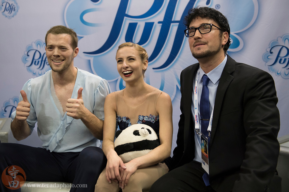 January 4, 2018; San Jose, CA, USA; Tarah Kayne and Danny O'Shea smile with coach Jim Peterson (right) in the kiss and cry after skating in the pairs short program during the 2018 U.S. Figure Skating Championships at SAP Center.