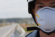 A portrait of a policeman at roadblock set up on Route 6 in Minami Soma reinforce the 20 kilometre exclusion zone around Fukushima Daiich nuclear power station which was damaged in the march 11th earthquake and tsunami causing radiation leaks and explosions. Minami Soma, Fukushima, Japan. Wednesday May 4th 2011
