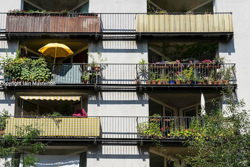 Balconies in summer in modern apartment building in Prenzlauer Berg district of Berlin Germany