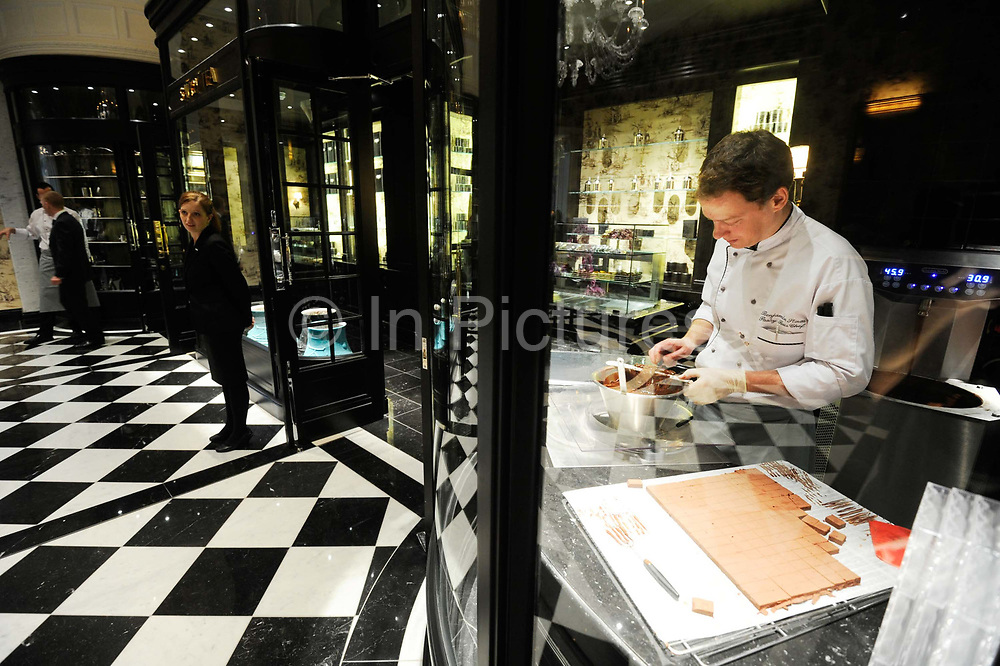 """A chocolatier prepares chocolates in the upper Thames foyer of the Savoy Hotel in London. The iconic hotel reopened after a three year refit that cost £220 million ($350 million). The Savoy Hotel is a located on the Strand, in central London. Built by impresario Richard D'Oyly Carte the hotel opened on 6 August 1889. It was the first in the Savoy group of hotels and restaurants owned by Carte's family for over a century. It has been called """"London's most famous hotel"""" and remains one of London's most prestigious and opulent hotels, with 268 rooms and panoramic views of London."""