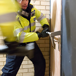 © Licensed to London News Pictures.  06/12/2012. MILTON KEYNES, UK. COLLECT PHOTO FROM TVP. Thames Valley Police officers enter a house as part of Operation Rouse. A total of 22 warrants were executed under the Misuse of Drugs Act in the Milton Keynes area this morning, with a further four carried out in the Metropolitan Police area and one in Northampton. 240 police officers were involved and 21 people arrested. A quantity of drugs, cash and weapons were seized. Photo credit :  TVP/LNP