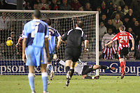 Photo: Pete Lorence.<br />Lincoln City v Wycombe Wanderers. Coca Cola League 2. 30/12/2006.<br />Jeff Hughes scores the one and only goal of the match.