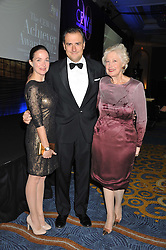 Left to right, LOUISA McCARTHY, DOMINIC McCARTHY and CAROLINE NEVILLE at the 20th CEW (UK) Achiever Awards 2012 - celebrating two decades of women, passion, beauty, held at the Hilton, park Lane, London on 16th October 2012.