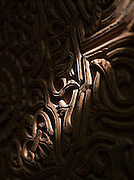 Light cast on a carved detail on a piece of wood in the wood workshop in Fes, Morocco