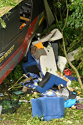 © Licensed to London News Pictures. 15/08/2012. Bath, UK. A coach carrying an American band called Baroness crashed off the road and down a slope at Brass Knocker Hill on the A36 near Bath. The band had played in Bristol last night and were en route to Southampton.  They have now announced they have cancelled the last gig of their tour.  15 August 2012..Photo credit: Simon Chapman/LNP