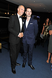 Left to right, DYLAN JONES and JIMMY CARR at the GQ Men of the Year 2011 Awards dinner held at The Royal Opera House, Covent Garden, London on 6th September 2011.