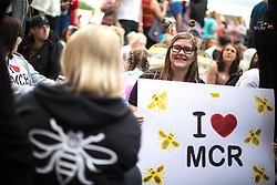 © Licensed to London News Pictures . 04/06/2017 . Manchester , UK . LIBBIE HUNTER (14 from Salford) with a home-made I Love Manchester placard , sitting on the ground in front of the stage . The One Love Manchester benefit concert for victims of the Manchester Arena terrorist attack , at the Emirates Old Trafford Cricket Stadium . Ariana Grande, Justin Bieber, Coldplay, Katy Perry, Miley Cyrus, Pharrell Williams, Usher, Take That, Robbie Williams, Black Eyed Peas and Niall Horan are amongst the performers . Photo credit : Joel Goodman/LNP