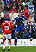 Photo: Steve Bond.<br /> Leicester City v Barnsley. Coca Cola Championship. 27/10/2007. Lewin Nyatanga (L) outjumps Collins John (C)