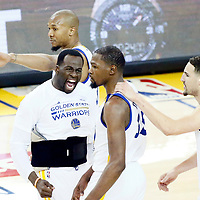 04 June 2017: Golden State Warriors forward Draymond Green (23) congratulates Golden State Warriors forward Kevin Durant (35) next to Golden State Warriors guard Klay Thompson (11) during the Golden State Warriors 132-113 victory over the Cleveland Cavaliers, in game 2 of the 2017 NBA Finals, at the Oracle Arena, Oakland, California, USA.