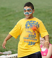 Middletown, New York - A boy from the Middletown YMCA summer camp performs during a talent show for parents and other campers on August 17, 2010.