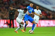 Raheem Sterling of England battles Andraz Kirm of Slovenia - England vs. Slovenia - UEFA Euro 2016 Qualifying - Wembley Stadium - London - 15/11/2014 Pic Philip Oldham/Sportimage