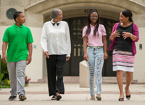 Parents, relatives and students pose for a photograph at Reagan High School, July 16, 2014.