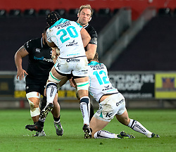 Ospreys' Alun Wyn Jones is tackled by  Connacht's John Muldoon<br /> <br /> Photographer Simon King/Replay Images<br /> <br /> Guinness PRO14 Round 19 - Ospreys v Connacht - Friday 6th April 2018 - Liberty Stadium - Swansea<br /> <br /> World Copyright © Replay Images . All rights reserved. info@replayimages.co.uk - http://replayimages.co.uk