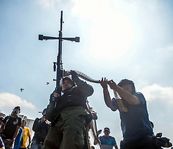 April 30, 2019 - Caracas, Miranda, Venezuela - An anti-government solider with a machine gun takes up position ready for battle. The Venezuelan opposition leader has called for the military to rise up against the President on Tuesday. (Credit Image: © Roman Camacho/SOPA Images via ZUMA Wire)
