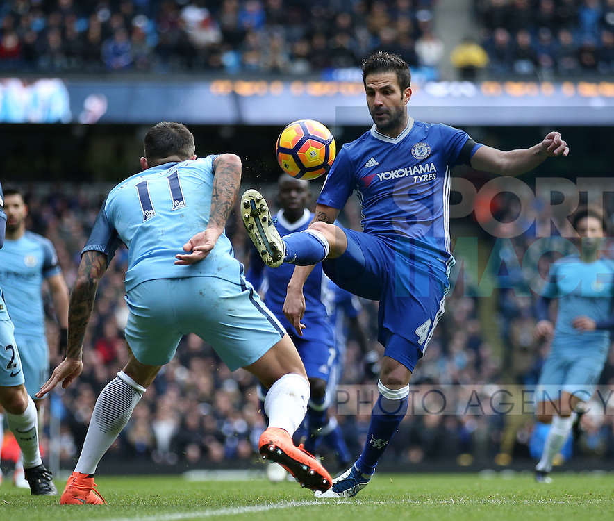 Cesc Fabregas of Chelsea tussles with Aleksander Kolarov of Manchester City during the Premier League match at the Etihad Stadium, Manchester. Picture date: December 3rd, 2016. Pic Simon Bellis/Sportimage