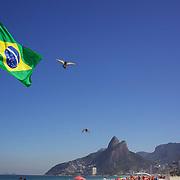 A Brazilian flag flies on Ipanema beach, Rio de Janeiro, Brazil. 6th July 2010. Photo Tim Clayton..