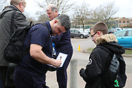AFC Wimbledon coach Simon Bassey signing autographs during the EFL Sky Bet League 1 match between AFC Wimbledon and Barnsley at the Cherry Red Records Stadium, Kingston, England on 19 January 2019.