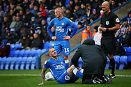 Peterborough United midfielder Marcus Maddison (21) had to go off after a bad tackle by Barnsley defender Dimitri Cavare (12)  during the EFL Sky Bet League 1 match between Peterborough United and Barnsley at The Abax Stadium, Peterborough, England on 6 October 2018.