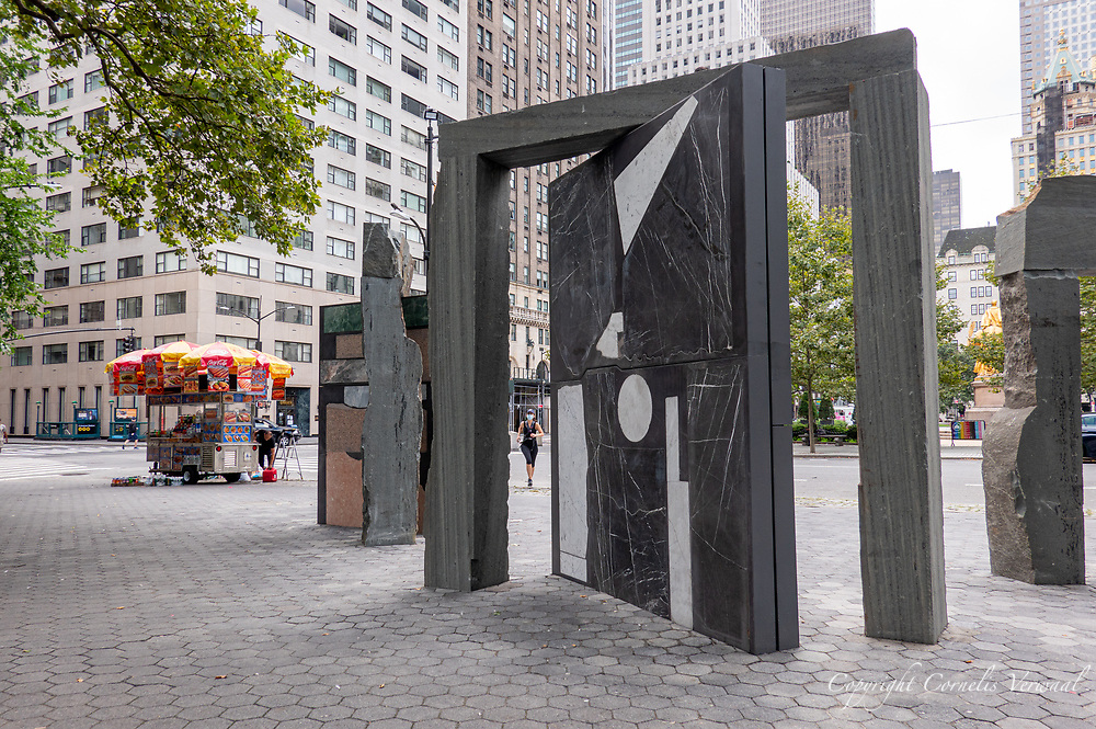 """""""Doors For Doris"""" by artist Sam Moyer. Stone forms the foundation and framework of New York City. It is the bedrock that supports the structures we inhabit and it clads many of the too. To mark the threshold between Central Park's boulder-filled terrain and Midtown Manhattan's built environment, Sam Moyer has created a massive three-part sculpture, with a title that pays homage to Public Art Fund founder, Doris C. Freedman.  Moyer's sculpture unites imported stone with rock indigenous to the New York region."""